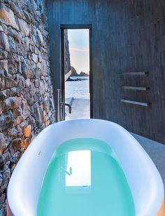 Modern Seascape Cottage Nestled in Rock Escarpment Offers Relaxing Oceanviews - My Modern Met