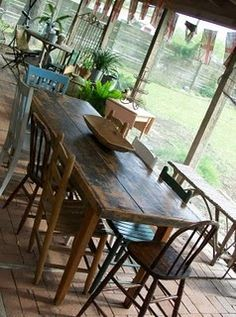 Cool rustic farmhouse table. Love the mismatched chairs.