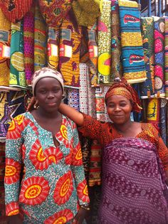 I'm in Ghana this week....and on my continuous search for fabrics. Happy to say I walked away with 18 yards from this lovely mother and daughter in Accra Women's Market.