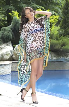 A very sexy kaftan from Vero Milano. This turquoise animal print kaftan has a sunshine yellow trim and makes the ideal beach or poolside accessory.