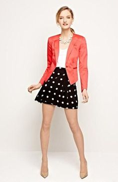 Shop this look on Lookastic:  http://lookastic.com/women/looks/necklace-blazer-tank-skater-skirt-pumps/9644  — Gold Necklace  — Red Blazer  — White Tank  — Black and White Polka Dot Skater Skirt  — Beige Leather Pumps