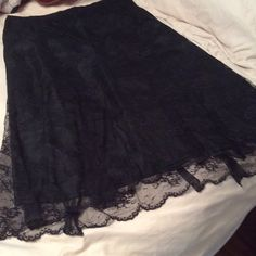 ☀️Price Drop☀️ Black Lace Skirt Size 10 A lined black skirt with lace overlay. So pretty worn once and doesn't fit anymore. Side zipper such a pretty skirt for a special occasion or with a cut casual tank for a night out. Nine & Co.  Skirts