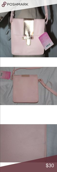 New Juicy Couture Pink & Gold Should Purse ALL BEST REASONABLE OFFERS ACCEPTED!New with tags still attached. PLEASE NOTE: Although this purse still has the tags attached and has never been used, there are two blackish/bluish marks from the shelf on the back of the bag (please see pictures) .75 inches and 2 inches respectively.  Width of bag: 7.5 inches Height of bag: 7.5 inches Strap length: Adjustable  This bag will look great on any casual outing. Juicy Couture Bags Shoulder Bags