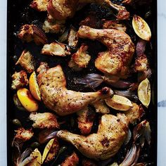 Chicken Roasted on Bread with Caperberries and Charred Lemon | In this supersimple dish from Justin Chapple, chicken legs roast on top of torn pieces of bread that absorb the rich and tangy juices, becoming deliciously crisp and chewy.