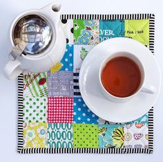 Adorable patchwork mini-placemats by red pepper quilts.