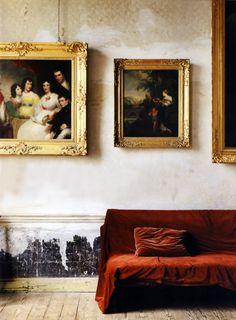 red velvet slip covered sofa and classical art
