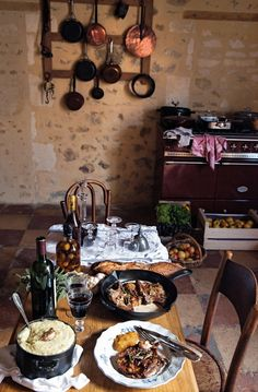 Mimi Thorisson's Dream Kitchen in Her French Chateau. The meal is served. The Lacanche stove and a collection of copper pots are seen in the background. Country Kitchen Tables, Country Kitchen Designs, French Country Kitchens, Rustic Kitchen, Pine Kitchen, Kitchen Ikea, Kitchen Stove, Kitchen Dining, Unfitted Kitchen