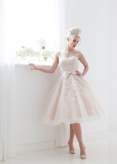 Poppy Dress house of mooshki. I think this is a stunning wedding dress. A little bit different and tea length. Love it.
