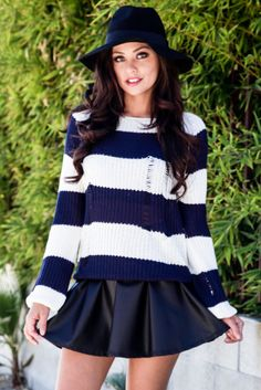 Gear up for winter with this amazing striped sweater. Features black and white stripes, bell sleeves and distressed detailing. Style it over your favorite collared shirt or pair it with your favorite skirt. $44 at Obsezz.com