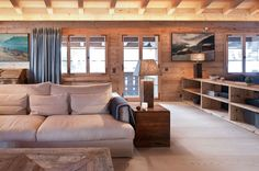 Warm Chalet Gstaad Interior With Modern Beige Fabric Sofa And Rustic Wooden Box Side Table Also Danish Fir Planks Floor And Exposed Beam Ceiling: Warm And Cozy Chalet in Gstaad Interior With Rough Wood