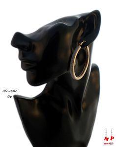 Boucles d'oreilles anneaux dorés entourés de paillettes argentées. Diamètre: 4,9cm.