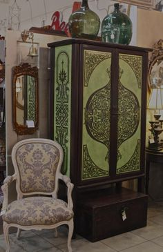 Eastern inspired Modello over Lime plaster gives this Oriental cabinet a unique flair of color and pattern.