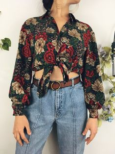 This blouse reminds us of enchanted gardens full of flourishing flowers! It's oversized cut it perfect to tie in a knot and paired with some rough denim. cute outfits for teen girls, cute outfits for women, women fashion casual, spring outfits for work, outfit ideas for women, outfit summer, hipster outfits, outfit for teens, outfit summer, vintage fashion 90s, vintage outfits 50s