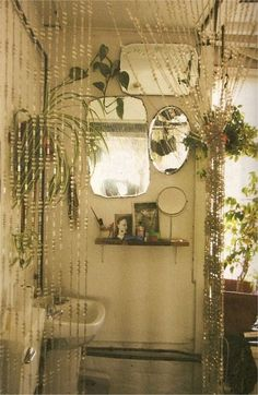 Bead curtain + multiple mirror in bathroom