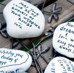 WEDDING WISHING STONES  A tradition said to originate in Ireland, guests are invited to inscribe their wedding wishes on smooth stones.  On the wedding guest book table the stones are then placed in vases of water, the symbolic indoor equivalent of throwing the stones into a river.