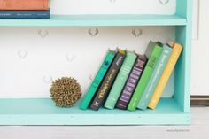 Gorgeous painted bookcase makeover! The before is unrecognizable! Chalk paint prettied this bookcase right up, plus a fun stamped backing to the inside shelves brightened it up! Antler stamped bookcase, so dang cute!
