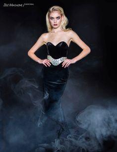Black velvet gown by Oseas Villatoro