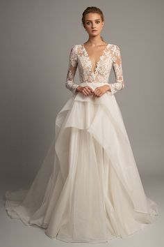 aa40f71d50126 The Valentina Gown is a romantic ball gown constructed of the finest French  Lace and elegant Silk Organza. The ethereal semi-sheer bodice has  sophisticated ...
