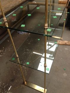 Brass and glass shelving by CDS
