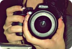 Another girl holding a camera.