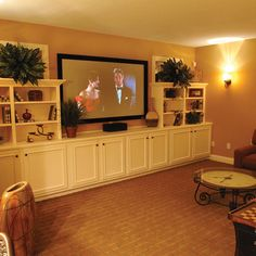 This would be so easy to DIY!  Stock cabinets, shelves, and trim. Basement Design Ideas, Pictures, Remodel and Decor
