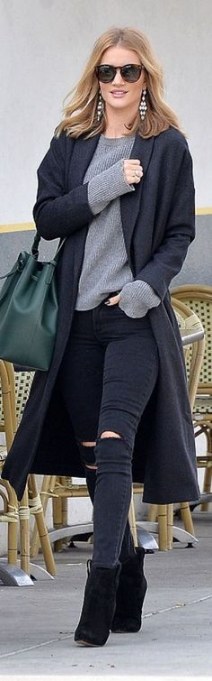 Who made  Rosie Huntington-Whiteley's brown sunglasses, black coat, gray ribbed sweater, gold jewelry, green bucket handbag, ripped black skinny jeans, and suede boots?