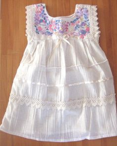Precious Handmade dress for your baby girl.  This dress has very intricate detailing, from the hand embroidered top to the delicate bow on the front.      This dress is made of a very lightweight cotton, making it perfect for late spring and all summer.      The measurement of the dress are:    1...