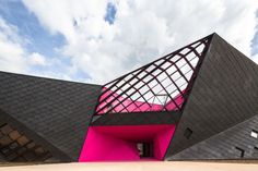 [Wkend Design Inspo] - French architect Paul Le Quernac designs Mulhouse Cultural Center using hot pink colors for roof.