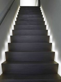 Indirect lighting-These stairs demonstrate a unique way to utilize indirect lighting to help you find your step.