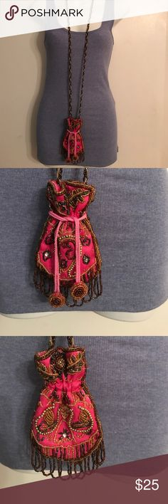 PERFECT BEADED BAG FOR ANYTHING PERFECT BEAUTIFUL BEADED BAG TO CARRY YOUR CELL, LIPSTICK OR ANY LITTLE THING YOU MIGHT NEED WHEN NOT WANTING TO CARRY A BIG BAG. GREAT FOR CARRYING LICENSE, PASSPORT ETC WHEN TRAVELING Bags Totes