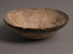 Bowl Date: 4th–7th century Geography: Made in Kharga Oasis, Byzantine Egypt Culture: Coptic Medium: Earthenware, slip decoration Dimensions: H: 1 7/8in.(4.7cm); Diameter: 5 9/16in.(14.1cm)
