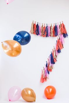 Celebrating a birthday? Make numbers or words out of tassel garlands for an easy + festive party decor option.