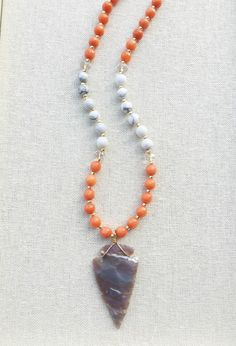 A personal favorite from my Etsy shop https://www.etsy.com/listing/475846893/gameday-orange-white-gemstone-necklace