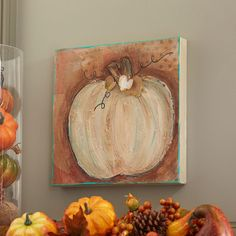 Add fall style to your wall when you make this easy DIY mixed media painted pumpkin.