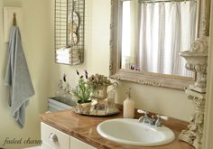 Love the basket with towels and clock faces in the bathroom.  Faded Charm: ~A Perfect Gray~