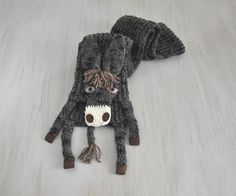 Very nice, soft yarn (acrylic + wool) with plastic eyes on textile, textile nostrils and hoofs Brown acrylic mane and the end of tail  Length without