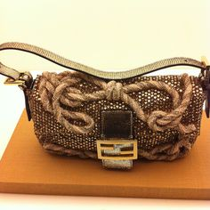Loving the beaded twisted rope knot detail on this Fendi Baguette!