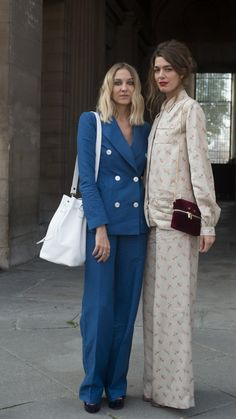 Power-dress to impress with this tailored blue, white buttoned suit and shoulder bag, or experiment with patterns and a clutch à la model on the right. See more street style inspired workwear at www.redonline.co.uk.