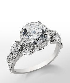 "Monique Lhuillier Floral Halo Engagement Ring - love the ""leaf"" ovals"