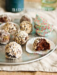 Raw Vegan Energy BallsRaw Vegan Bliss Balls     2 ripe bananas mashed     5 dates chopped finely     1/2 c raisins soaked      1/2 c coconut plus another 1/2 c to roll the balls in     3 T raw cacao powder     2/3 c oats plus 1/3 c to roll the balls in     3 teaspoons honey      1 t vanilla      1/2 t cinnamon