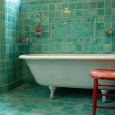 Clawfoot tub and blue-green sea-green peacock green tile! love it!