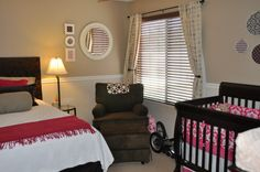 I really like the idea of having a bed or a pull-out couch in the nursery for additional help or guests or for a place for mom or dad to crash! I also like the neutral palette of this room that is accented with the dark pink.