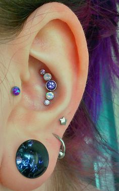 It is violac topaz white faux opal and amethyst. Purple faux opal labret in my tragus by Neometal and a 7/16 (11mm) grape galaxy plugs by Glasswear Studios. All bought from Bodyartforms.