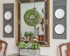 Really like the plates hung on painted bi-fold doors in this dining room at worthingcourtblog