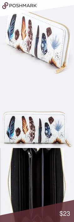 """NWT White Feather Statement Wallet Make a statement while you shop! Stunning White Wallet with Multi Colored Feather pattern.  Gold zip closure. 6 Credit Card slots on both sides (12 total) Zippered Coin pouch Cash Pocket Behind Both Sides of Credit Card Slots Extra Divider for Phone or Receipts. 3 Separate Compartments in Center. -Polyurethane -Length 7.5"""" Width 1"""" Height 4"""" October Love Bags Wallets"""