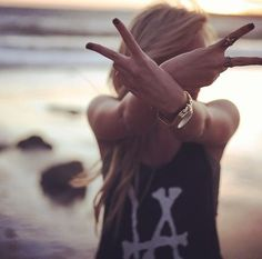 Classic hipster pose. peace sign. LA. artsy background.