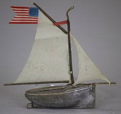 German Dresden silver sailboat with cloth sails and flying the American flag