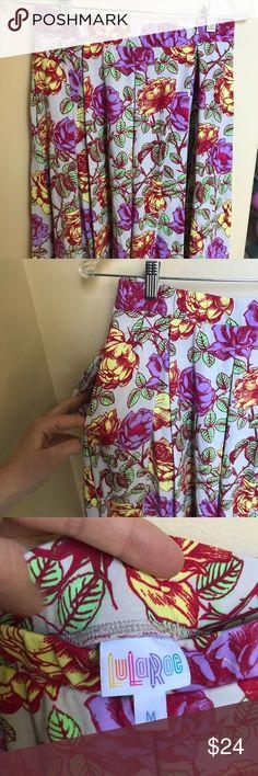 Lularoe Madison skirt size medium Beautiful print, super soft Lularoe Madison skirt with pockets! Size medium. Light gray background with yellow and pink floral print. LuLaRoe Skirts