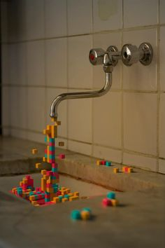 Blocks spilling out of a faucet like water