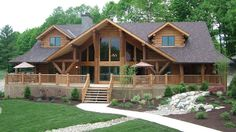 A very popular large log home, The Big Sky features enormous glass front, 3903 sq. ft., wrap-around porch, 4 bedrooms, 4 baths, centered great room